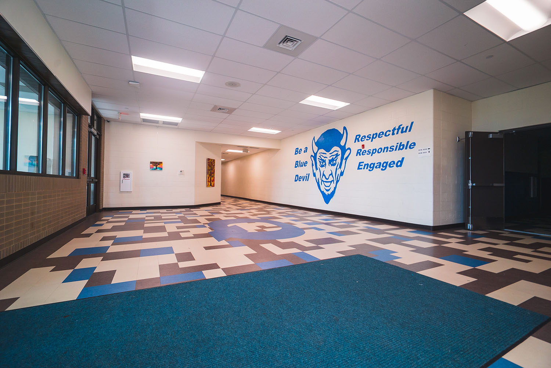 Quincy High School hallway with mascot mural